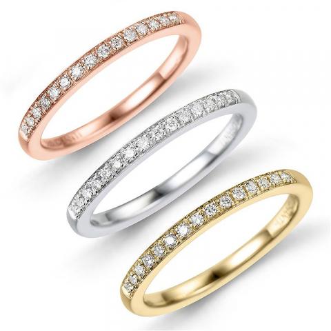 Tre i en ring i 14 karat alm.- hvid- og rødguld 0,27 ct