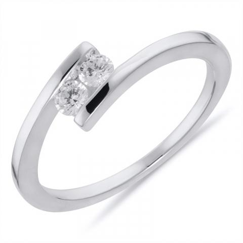 Smuk hvid zirkon ring i rhodineret sølv