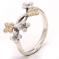 Blomster ring i oxideret sterlingsølv med 8 karat guld